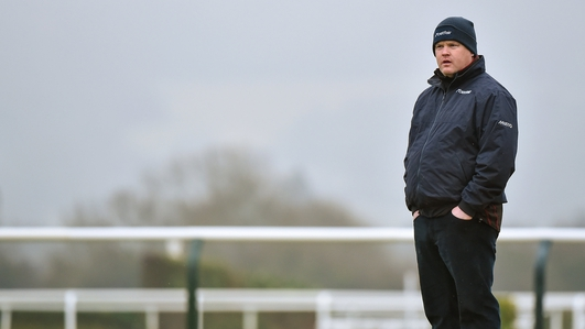 Picture Of Trainer, Gordon Elliott Sitting On A Dead Horse