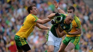 Éamonn McGee, left, and Leo McLoone tackle Kieran Donaghy during the 2014 All-Ireland final