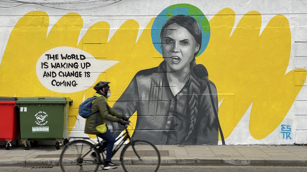 A large mural of Greta Thunberg spans the side of a building in Dublin City centre.