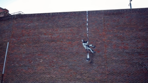 A new painting appeared on the side of a former prison in Reading overnight on Sunday