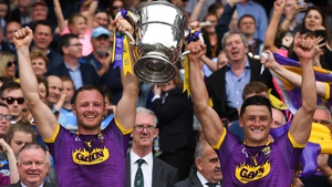 Joint Wexford captains Matthew O'Hanlon (L) and Lee Chin lift the Bob O'Keefe Cup two years ago