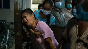 The mother of a protester mourns at a hospital after her son was killed during clashes in Yangon