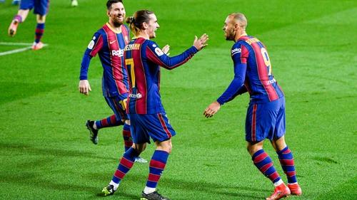Lionel Messi and Antoine Griezmann race to congratulate Martin Braithwaite as the Denmark international scores Barcelona's third goal against Sevilla