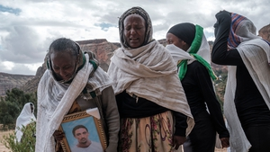People gather to mourn the victims of a massacre allegedly perpetrated by Eritrean soldiers in the village of Dengolat