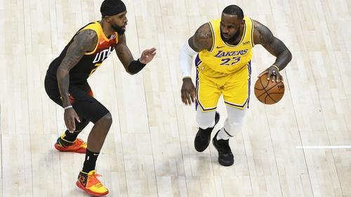 LA Lakers LeBron James (R) takes on Royce O'Neale of the Utah Jazz in Salt Lake City last month
