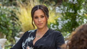 Meghan oozes classic glamour in Armani for Oprah interview