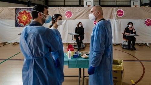 School staff waiting for the anti-Covid vaccine in their gym hall in Molfetta, Puglia, Italy