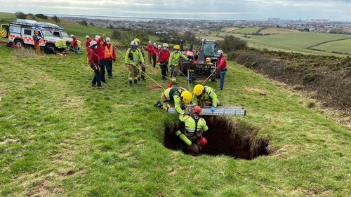 The man was discovered in the hole in the field (Pic: Twitter/@CumbriaFire)