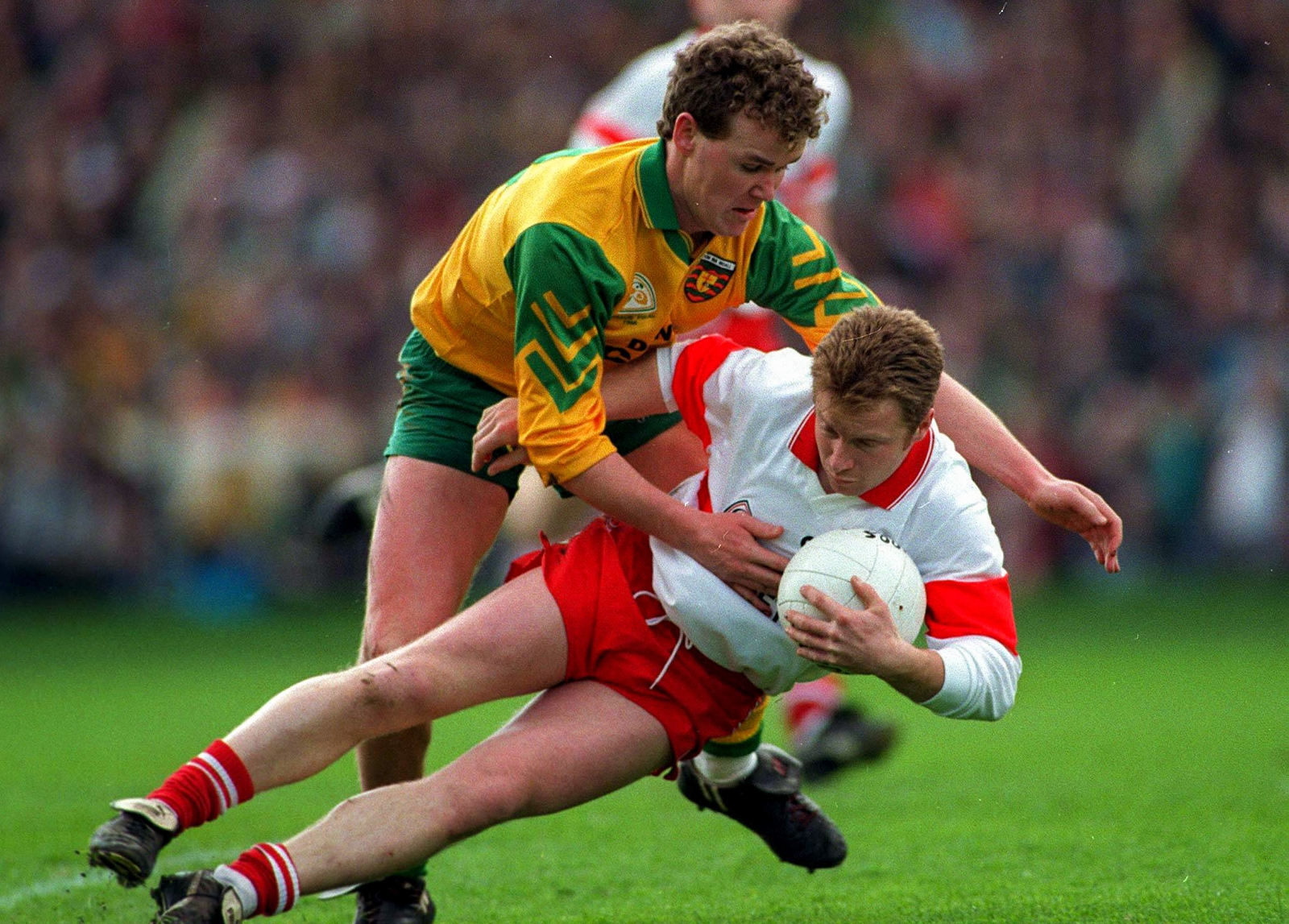 Image - McKeever in action against Tony Boyle of Donegal during the 1996 league final
