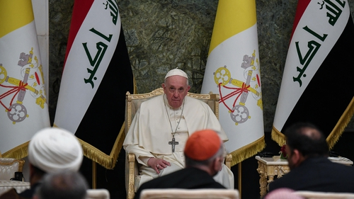 Pope Francis attends a meeting with authorities, civil society and the diplomatic corps in the hall of the Presidential palace in Baghdad
