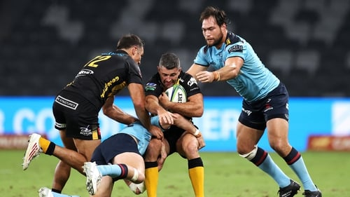 Rob Kearney is halted in his tracks by the Waratahs defence