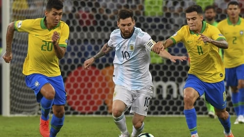 Argentina's Lionel Messi (C) is marked by Brazil's Roberto Firmino (L) and Philippe Coutinho during the 2019 Copa America
