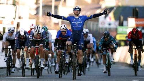 Sam Bennett crosses the line in first for Team Deceuninck - Quick-Step