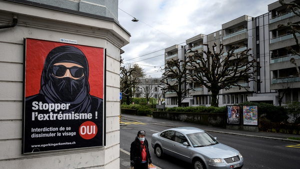 A poster urging a yes vote in the face covering referendum in Lausanne