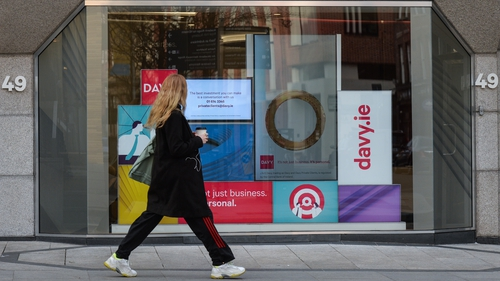 """The Davy Group HQ in Dublin where the company's slogan """"it's not just business, it's personal"""" can be seen in the window. Photo: Artur Widak/NurPhoto via Getty Images"""