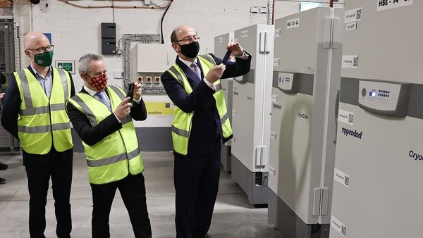 Minister for Health Stephen Donnelly takes delivery of the first doses of the Pfizer/BioNTech jab
