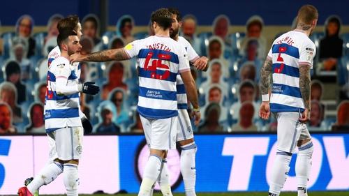 Ilias Chair is congratulated by QPR team-mate Charlie Austin