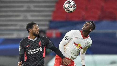 Wijnaldum in action against Leipzig's Amadou Haidara (R)