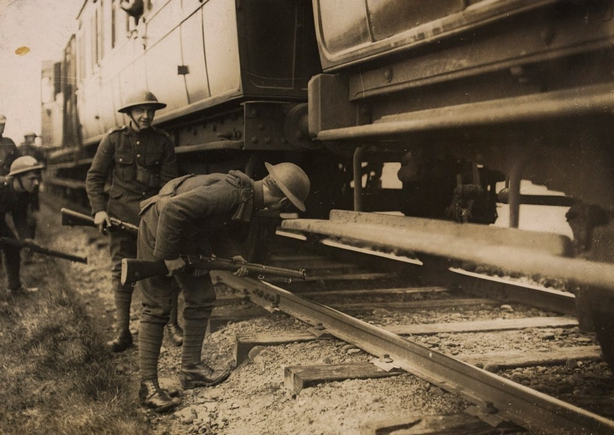 Soldiers searching trains for 'wanted men' in Co. Kerry in 1921. Photo: National Library of Ireland, HOGW 112