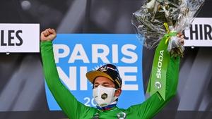 Primoz Roglic celebrates in his green jersey