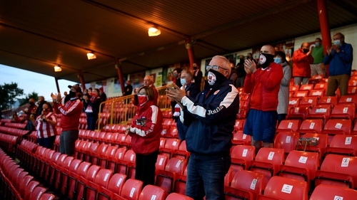 Fans must be socially distanced and wear masks throughout the event