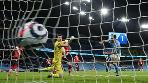 Ilkay Gundogan scores City's third goal on the stroke of half-time