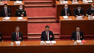Politburo Standing Committee member Wang Yang (L), President Xi Jinping (C) and Premier Li Keqiang attend the closing session of the National People's Congress