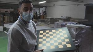 David Ferrer, CEO of Rechapados Ferrer holding one of his chessboards.