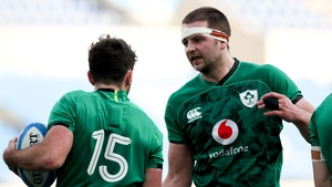 Iain Henderson (R) and Hugo Keenan in action against Italy