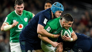 Ireland's Jonathan Sexton (R) is tackled by Scott Cummings during last year's Six Nations