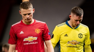 Scott McTominay and Dean Henderson react to Milan's late equaliser