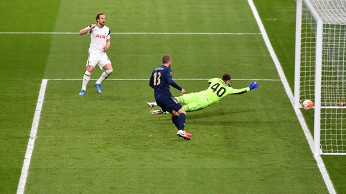 Harry Kane scores past Dinamo Zagreb goalkeeper Dominik Livakovic