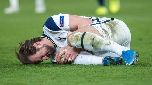 Harry Kane on the ground after taking a bang on the knee against Zagreb