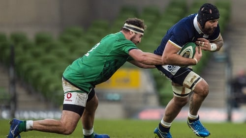 Rob Herring (left) tackles Scotland's Blade Thomson during the Autumn Nations Cup