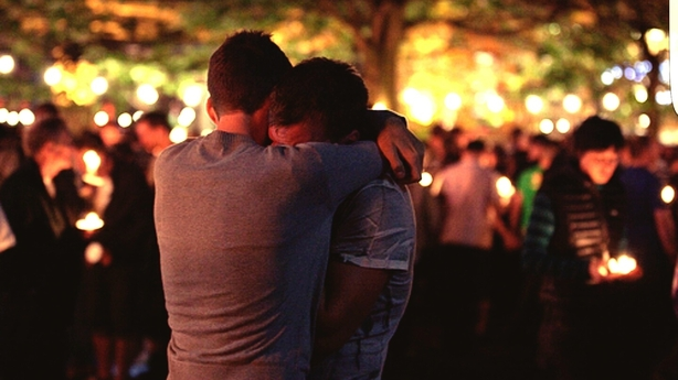 two men hugging and grieving