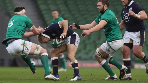 Scotland's Jaco Van Der Walt (c) is tackled by James Ryan (l) and Iain Henderson during the Autumn Nations Cup