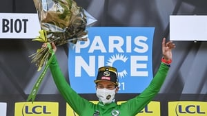 Primoz Roglic celebrates after taking hold of green jersey for best sprinter on the podium at the end of the sixth stage