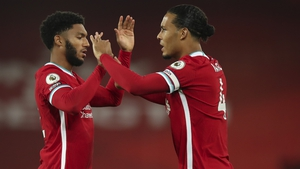 Joe Gomez (L) and Virgil van Dijk