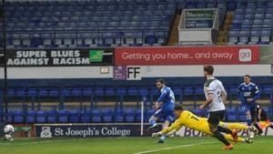 Troy Parrott sliding home his goal