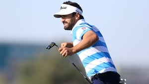 Antoine Rozner celebrates as he watches his winning putt drop into the hole