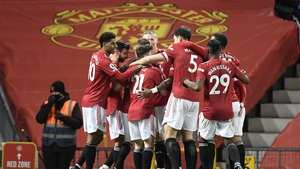 United players celebrate the only goal of the game at Old Trafford