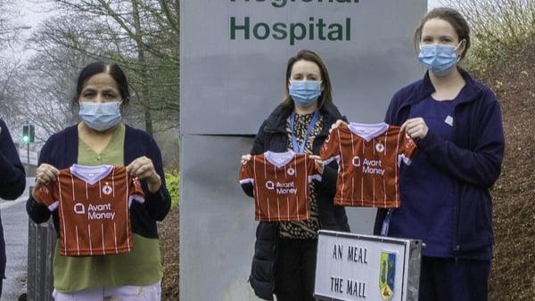 The tiny Sligo Rovers jerseys are held by some of Sligo hospital's dedicated nursing staff