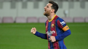 Leo Messi celebrates his second, and Barcelona's fourth goal against Huesca