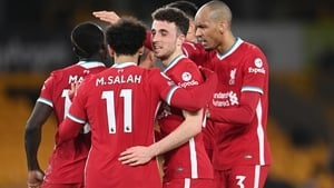 Diogo Jota (C) celebrates with his Liverpool team-mates after scoring at Molineux