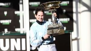 Rachael Blackmore holds the Champion Hurdle trophy aloft