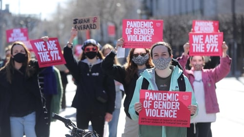 Protesters held placards saying 'pandemic of gender violence' and 'end victim blaming'