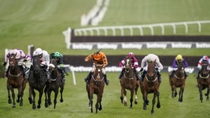 Aidan Coleman riding Put The Kettle On (orange) prevails on the run to the line