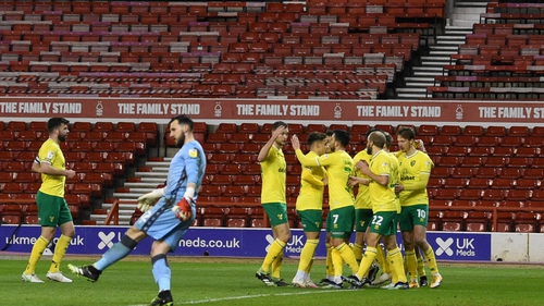 Kieran Dowell is mobbed after his goal for Norwich