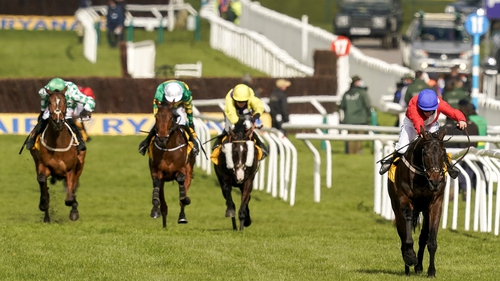 Rachael Blackmore and Allaho (red) clear the last to win the Ryanair Chase