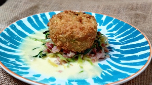 Mags Roche's colcannon potato cake with buttered cabbage and smoked bacon cream sauce.